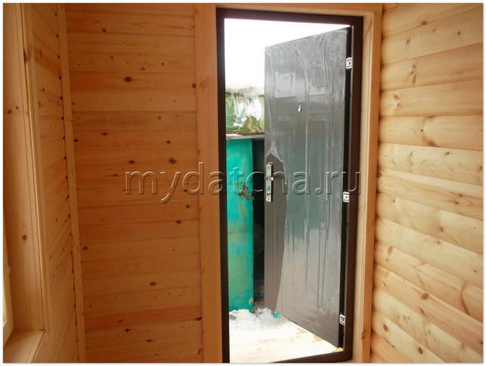 металлическая дверь в брус